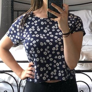 It is dark blue cropped floral t-shirt.